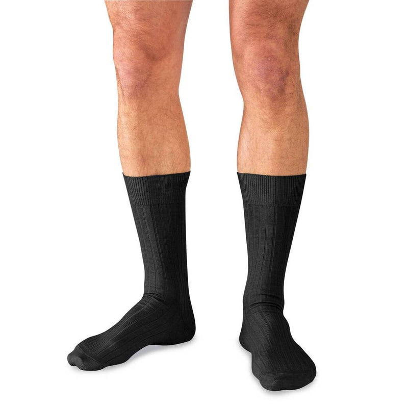 Man Wearing Mid-Calf Length Black Dress Socks