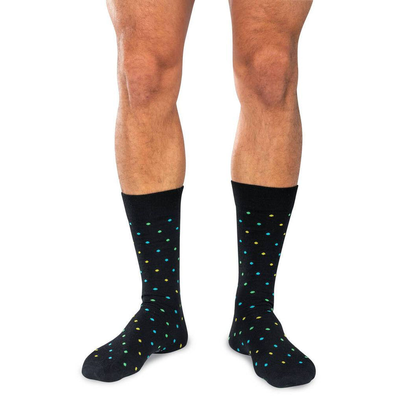 Man Wearing Mid-Calf Length Black Patterned Dress Socks