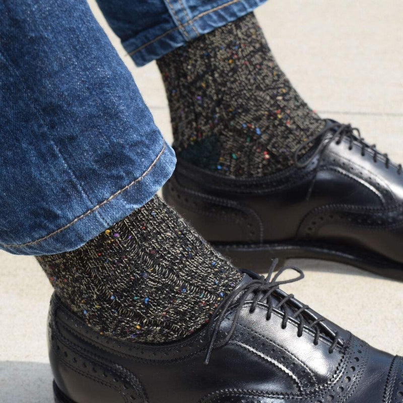 Man Wearing Black Brogues and Denim with Black and Khaki Donegal Wool Socks