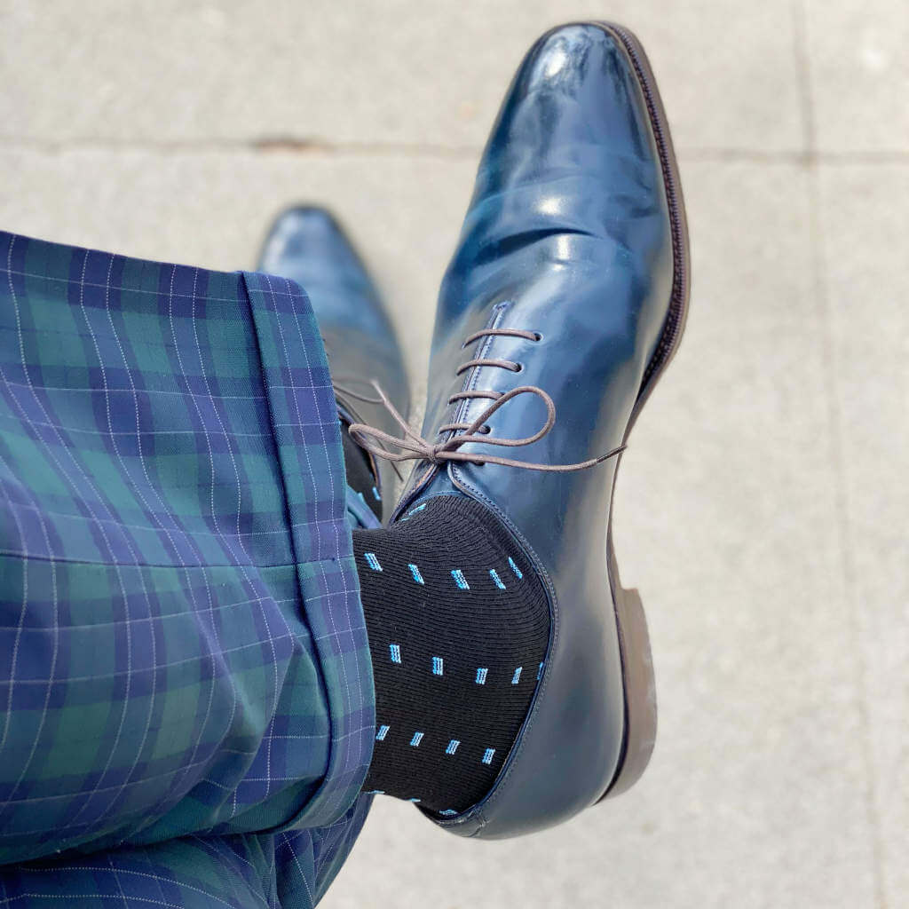 Black and Blue Patterned Dress Socks with Blue Dress Shoes and Plaid Pants