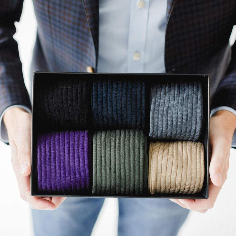 Man Holding Small Black Gift Box Filled with Colorful Men's Dress Socks