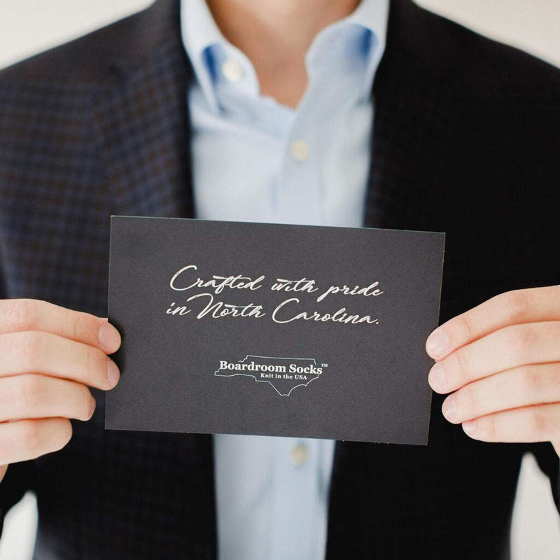 Man Holding Card that Says Crafted with Pride in North Carolina