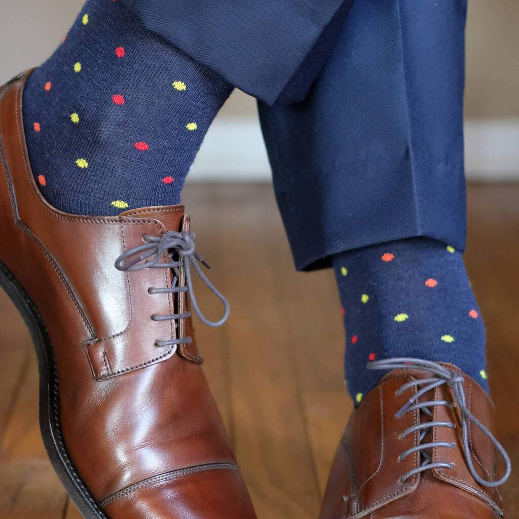 Man Wearing Patterned Navy Blue Dress Socks with Navy Blue Dress Pants and Brown Dress Shoes