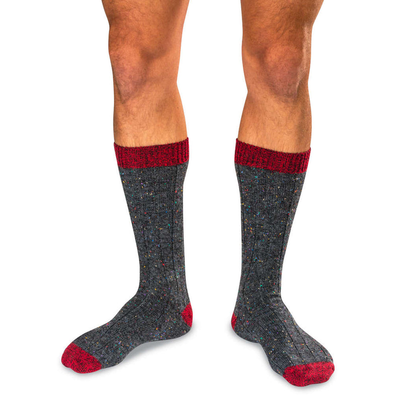 Man Wearing Grey Donegal Wool Blend Socks with Bright Red Accents
