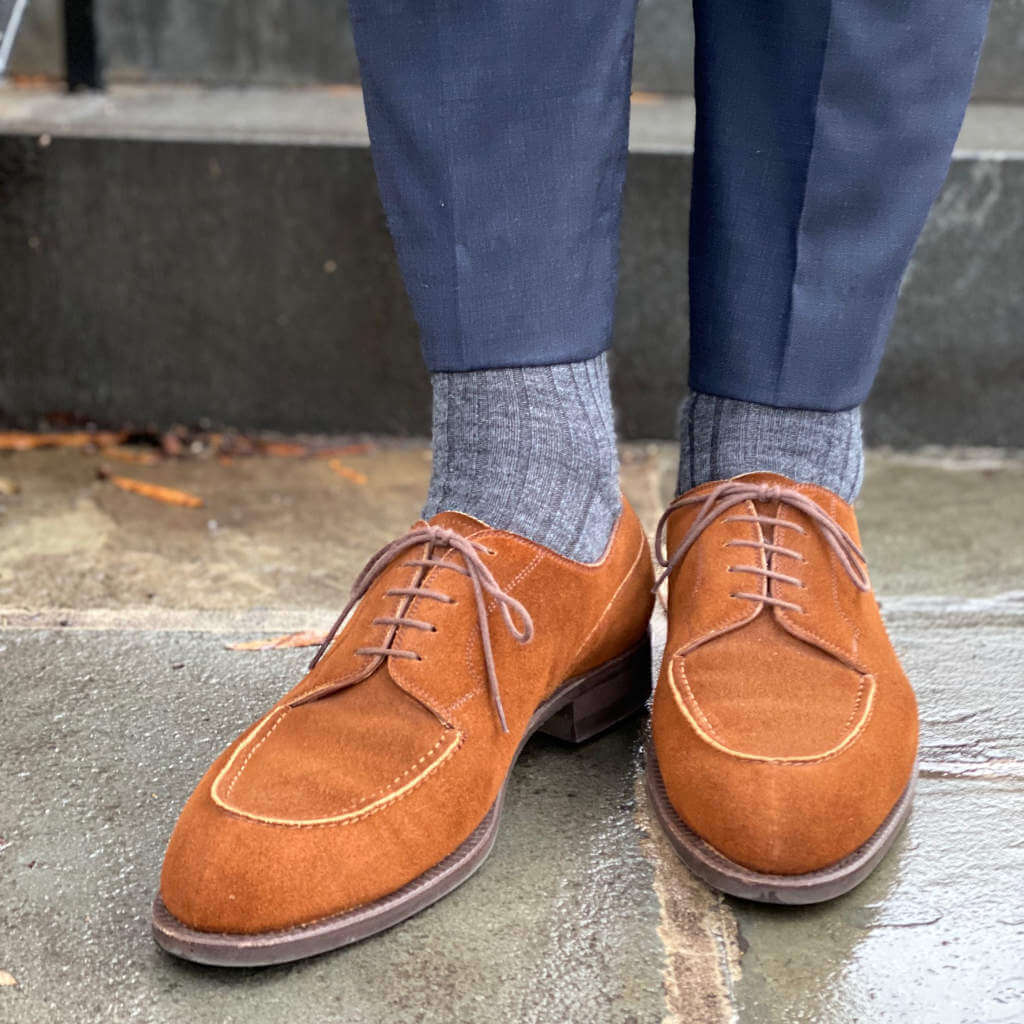 Man Wearing Navy Blue Dress Pants with Grey Merino Wool Dress Socks and Light Brown Suede Shoes