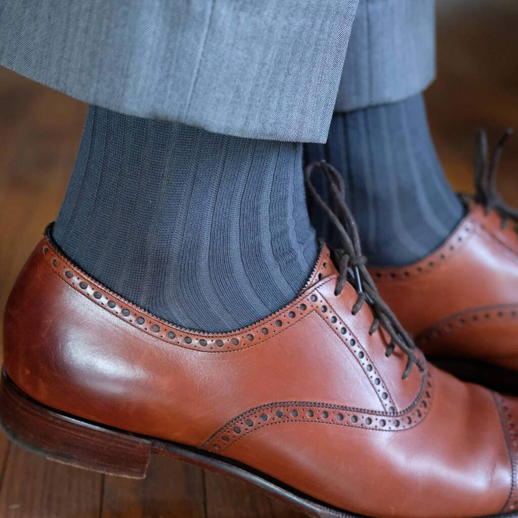 Man Wearing Ribbed Grey Cotton Dress Socks with Grey Dress Pants and Light Brown Brogue Dress Shoes