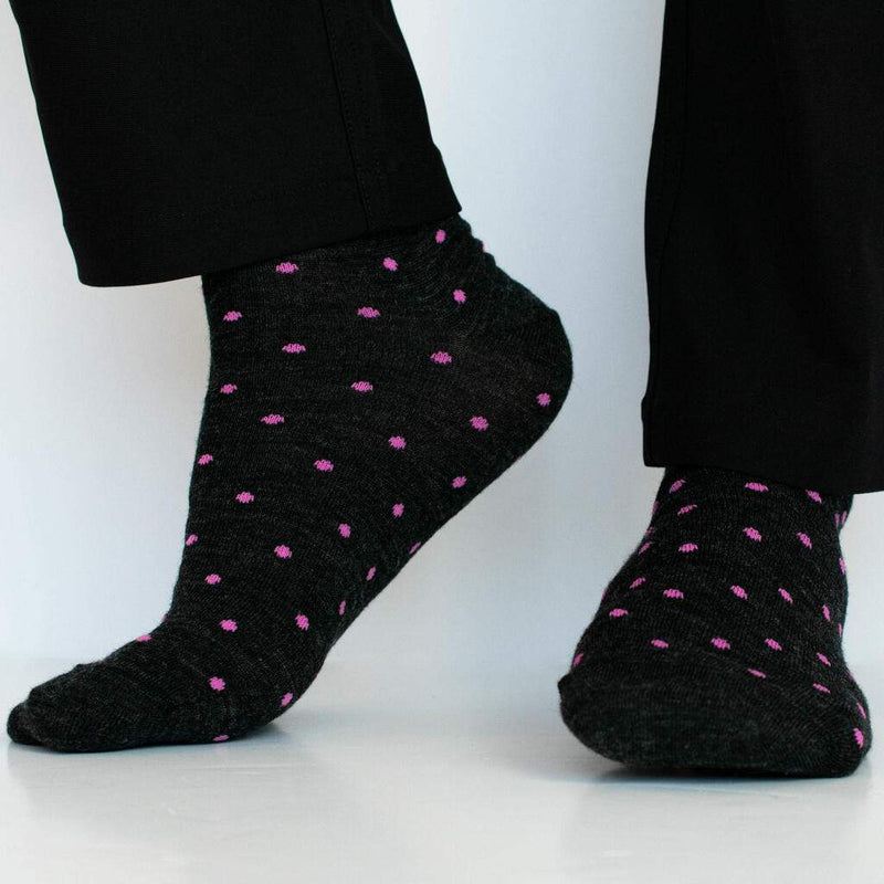 Man Wearing Charcoal Grey Dress Socks Decorated with Pink Polka Dots