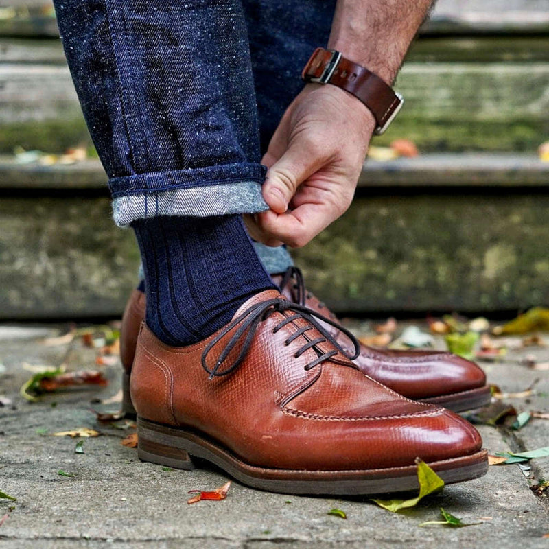 Man Wearing Navy Blue Merino Wool Dress Socks with Denim and Brown Dress Shoes