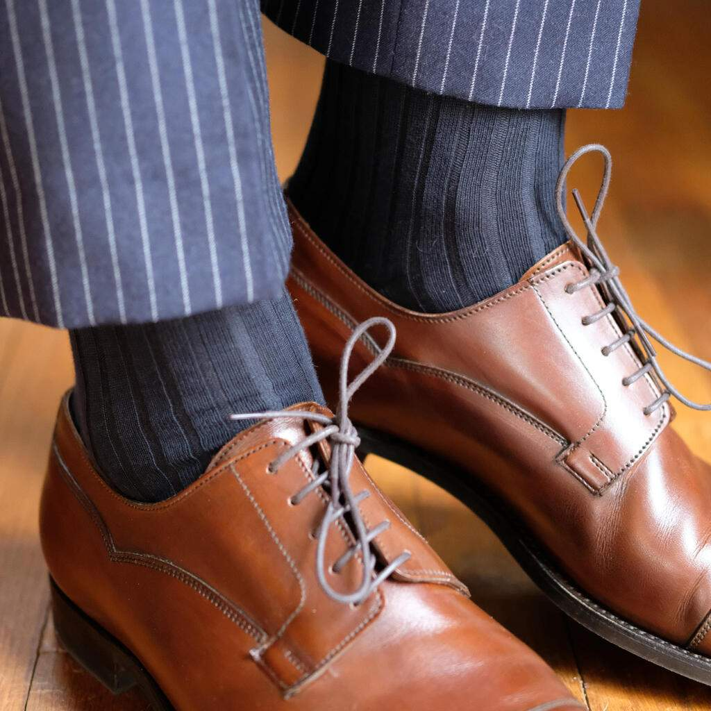 Man Wearing Navy Blue Cotton Dress Socks with Navy Pinstripe Dress Pants and Brown Dress Shoes