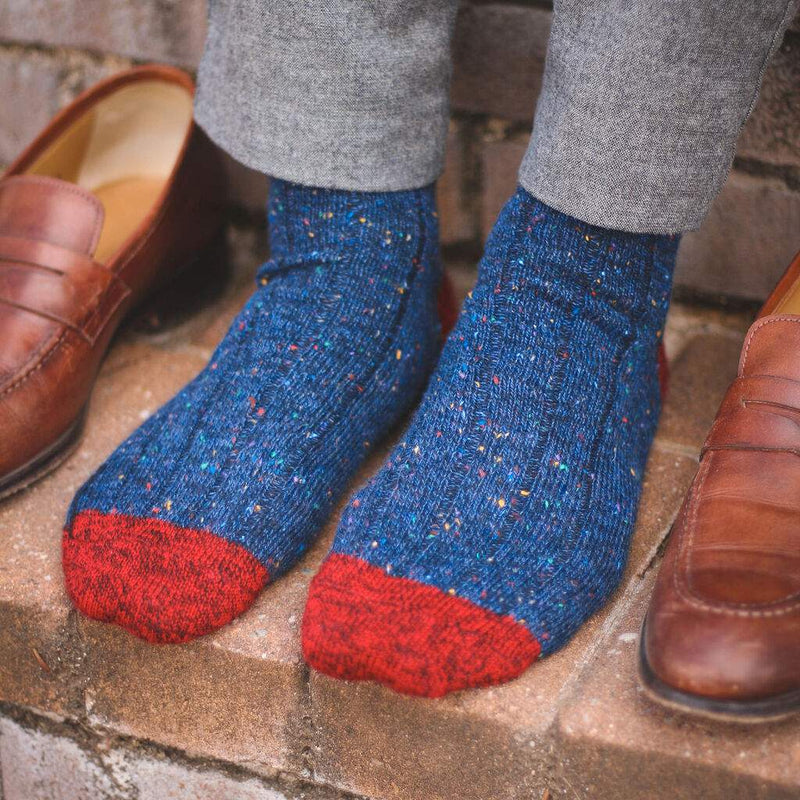 Man Wearing Navy Blue Donegal Wool Socks with Grey Dress Pants and Light Brown Loafers