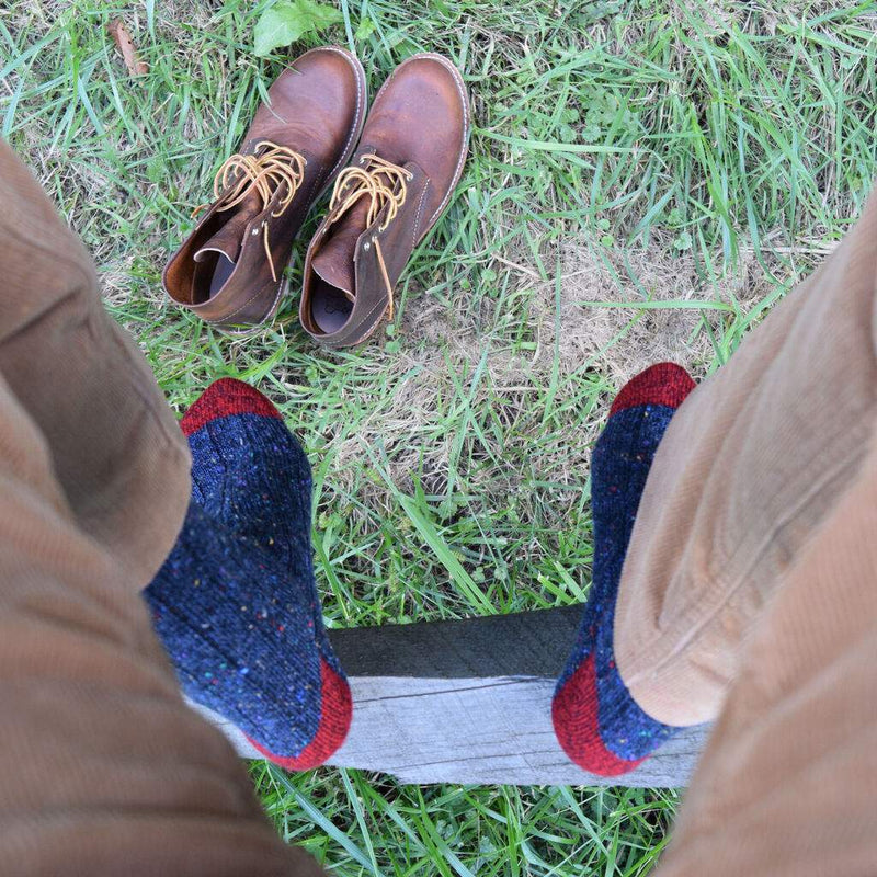 Man Wearing Navy Blue Donegal Wool Socks with Tan Corduroy Pants and Brown Boots