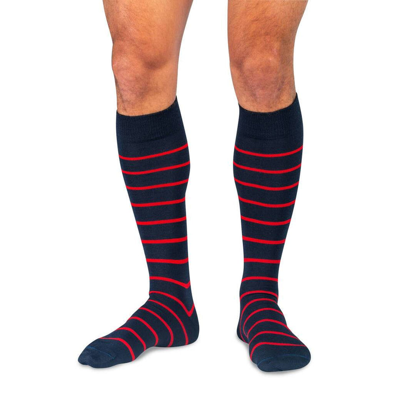 Model Wearing Navy Blue Over the Calf Dress Socks with Red Stripes
