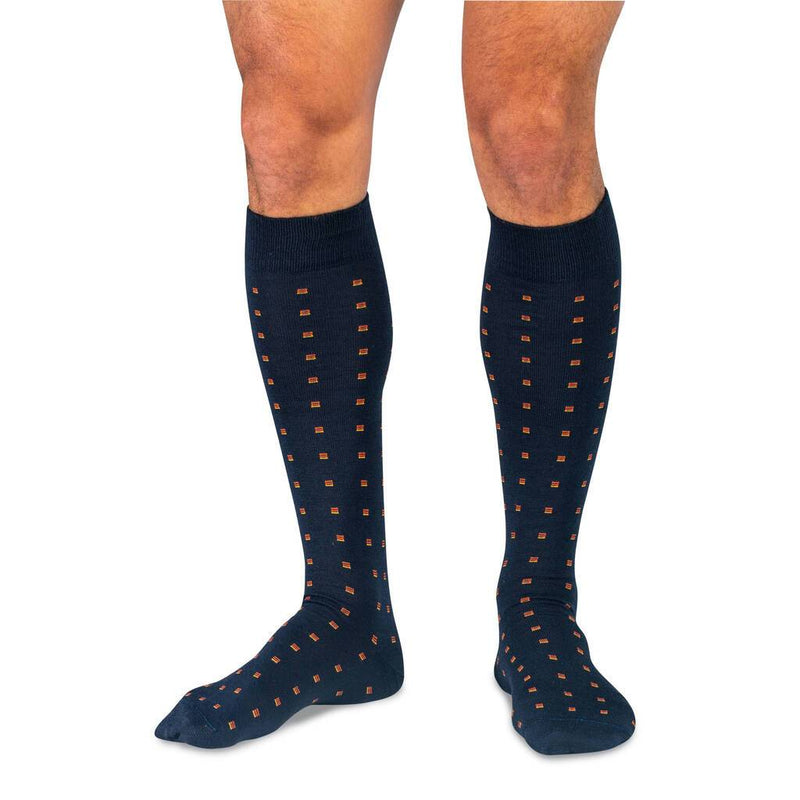 Model Wearing Navy Over the Calf Wool Dress Socks with Orange Squares