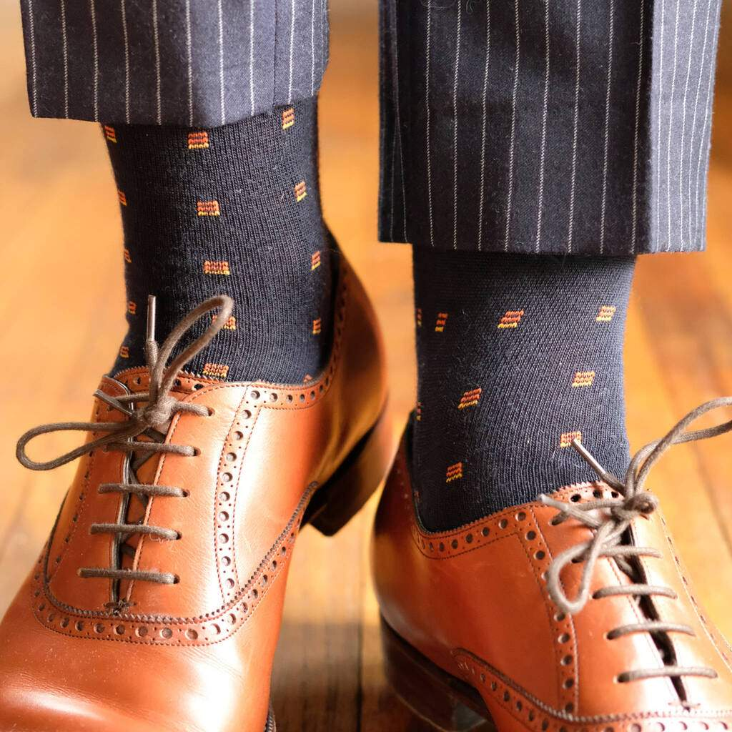 Man Wearing Navy Blue Wool Dress Socks with Navy Pinstripe Pants and Light Brown Dress Shoes