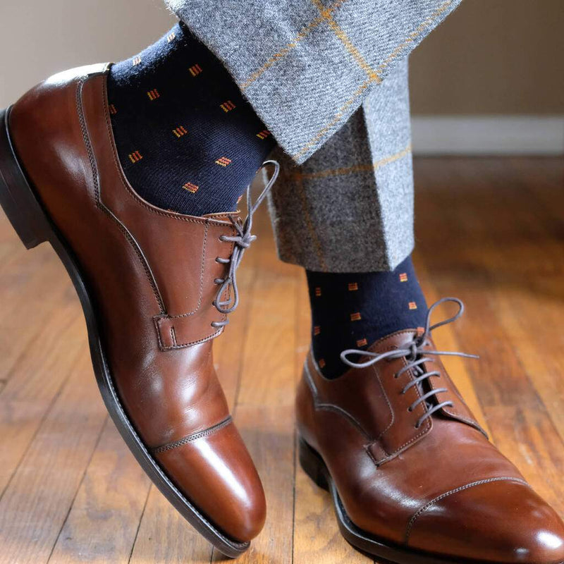 Man Wearing Grey Windowpane Wool Trousers with Navy Blue Wool Dress Socks and Brown Captoe Dress Shoes