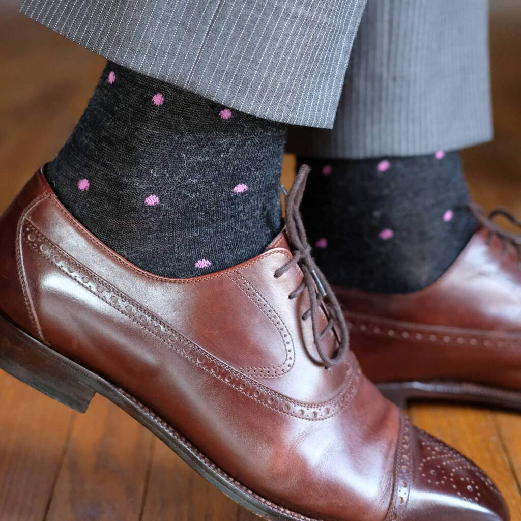 Man Wearing Charcoal Wool Dress Socks with Pink Dots and Brown Dress Shoes