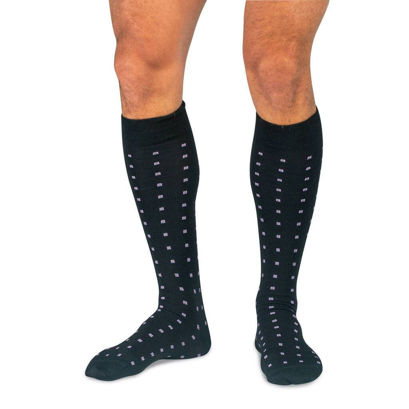 Model Wearing Black Wool Over the Calf Dress Socks Decorated with Purple Pattern