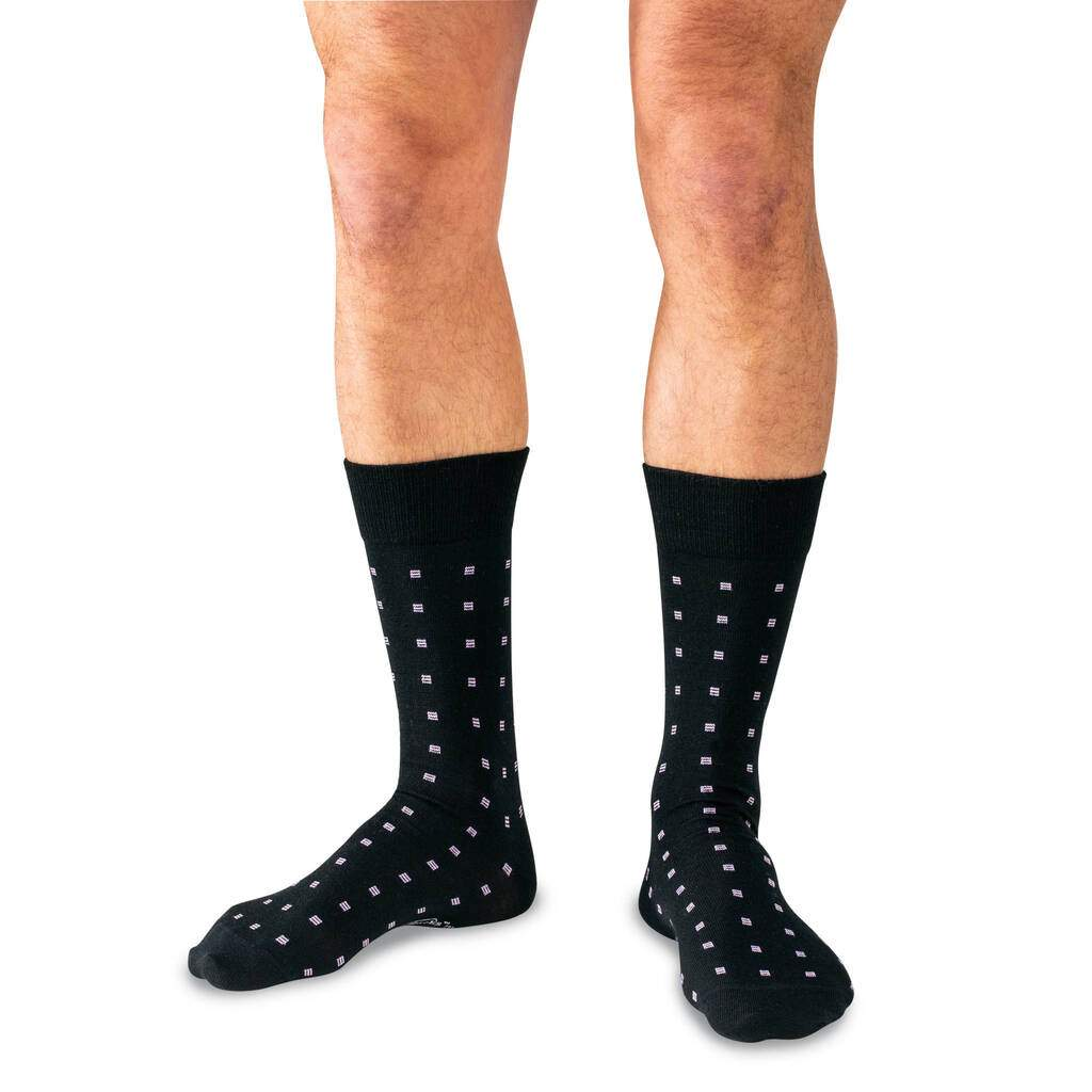 Man Wearing Black Mid-Calf Length Wool Dress Socks Decorated with Purple Squares