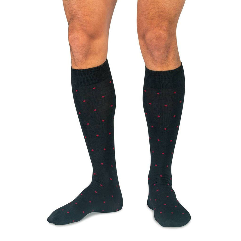 Man Wearing Black Wool Over the Calf Dress Socks with Red Dots