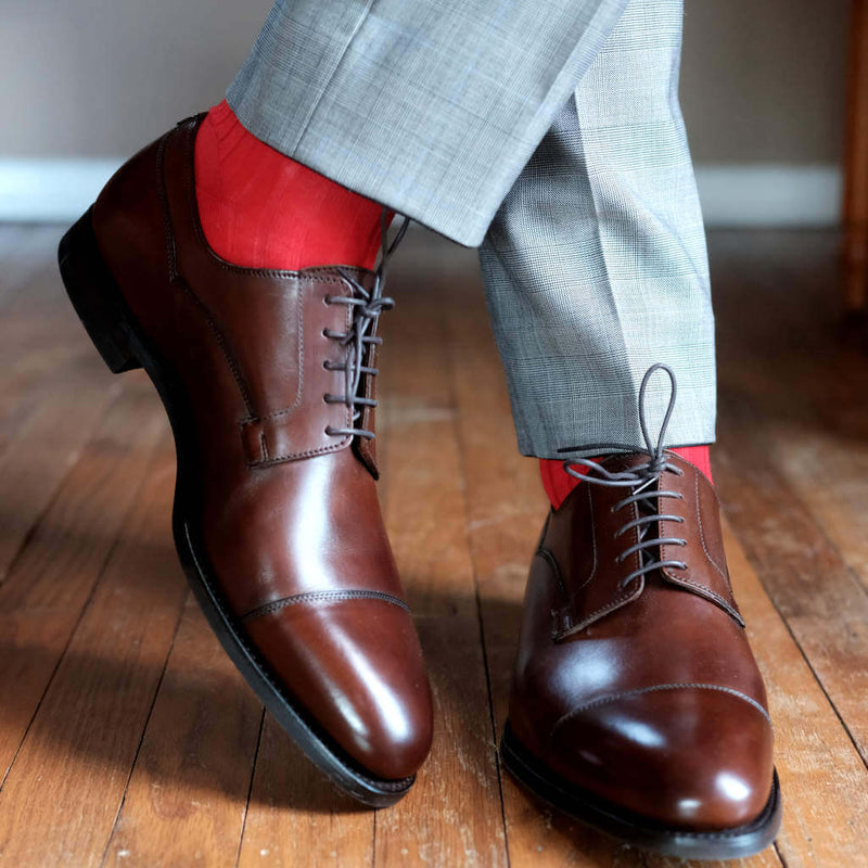 Man Wearing Grey Trousers with Red Dress Socks and Brown Captoe Dress Shoes