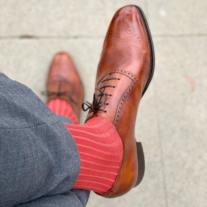 Man Wearing Grey Pants with Rust Orange Dress Socks and Brown Brogues