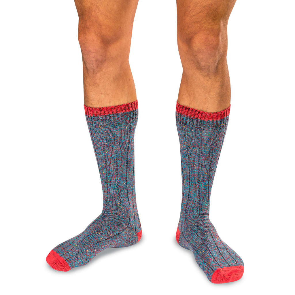 Model Wearing Teal and Red Twist Donegal Men's Socks
