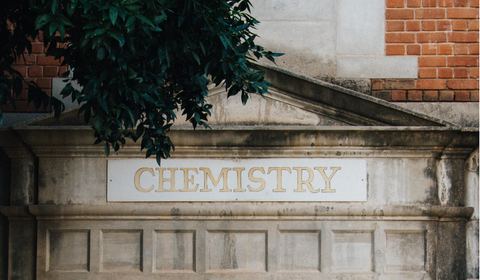 a roman building with the word chemistry etched into the title above the columns