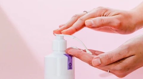 woman hands pumping lotion from bottle