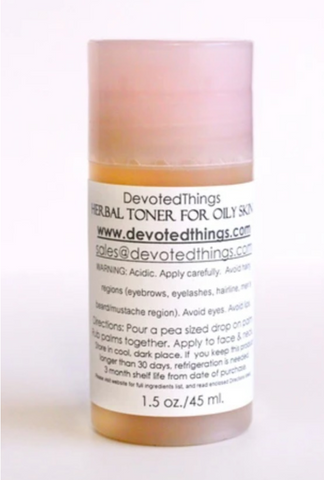 bottle of Devotedthings toner for oily skin in a clear cylindrical bottle