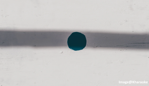 a blue paint circle with a gray line shadow and a white background