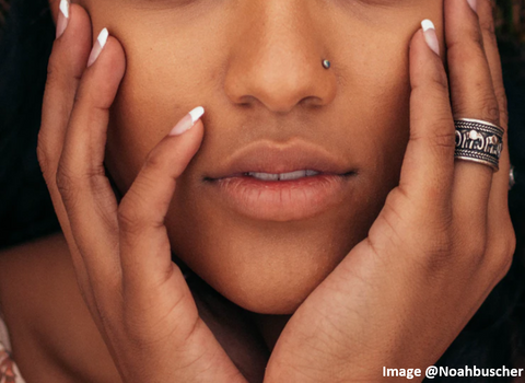 african american woman cropped face picture showing her nose and mouth with both hands cupping the sides of her face