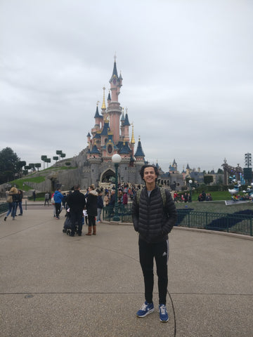 William at Euro Disney with bag on
