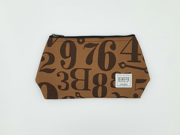 The Numerals Toiletry  + Makeup Bag