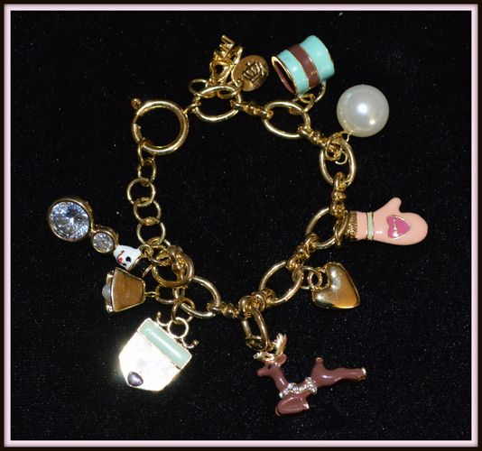 Juicy Couture 2012 Christmas Bracelet Collectible New Condition Pre Owned Dashing Reindeer Hot Cocoa Mitten Enamel Charms Toggle Closure