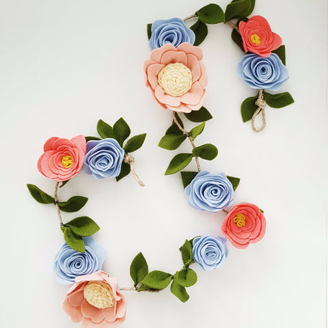 This garland is a beautiful collection of hand cut wool felt flowers and leaves strung on a metre length rope.