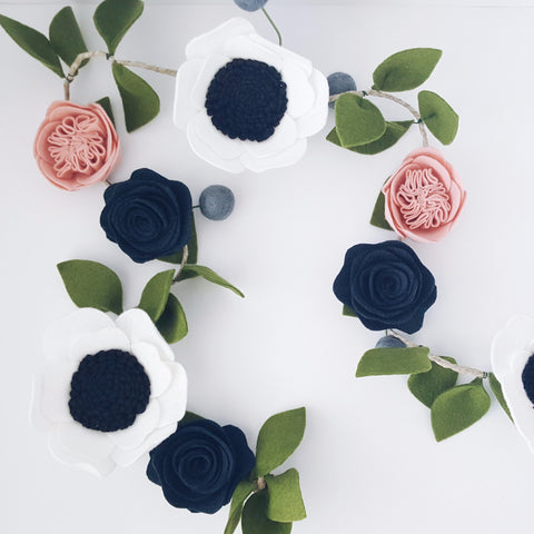 This garland is a beautiful collection of hand cut wool felt flowers and leaves strung on a 4 feet rope.