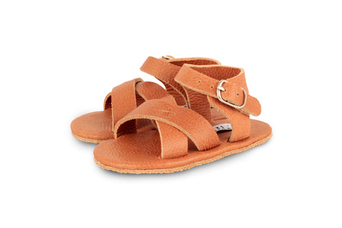 Donsje Cognac Giggles leather sandals with a cross over strap detail at the toes | POCO KIDS