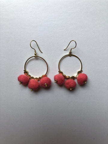 Dangling Pom Earrings in Orange by Mata Traders
