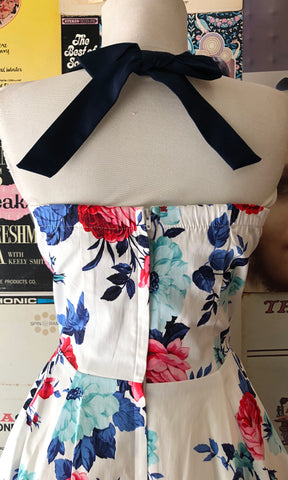 White Floral Halter Dress with Navy Bow by Eva Rose