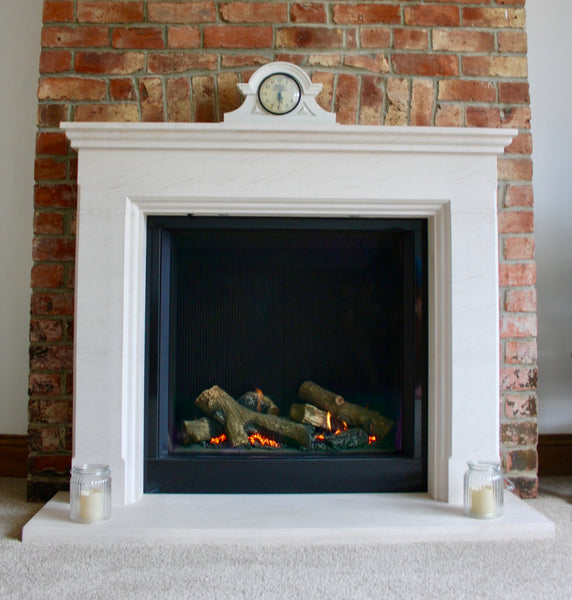 Gazco riva 750, logs, black reeded, lime stone surround, brick work, gas fire, Newcastle, gateshead, blazes fire surrounds