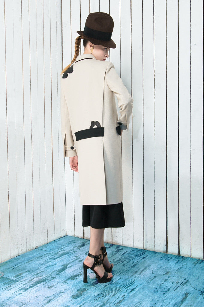 Coat with leather details