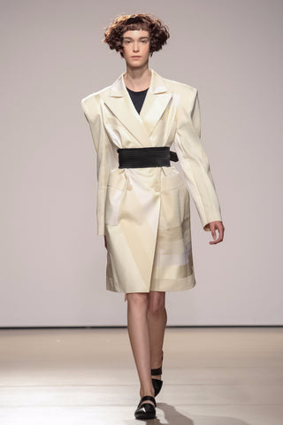 Coat with exaggerated shoulders