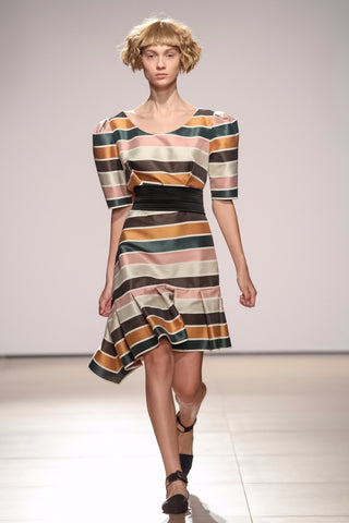 Dress with exaggerated shoulders and assymetric hem