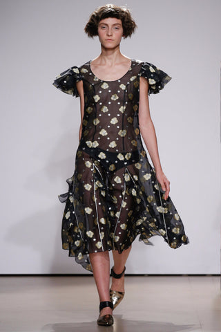 Dress with volants and frilling