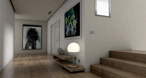 wood flooring in a clean, modern house with paintings on wall
