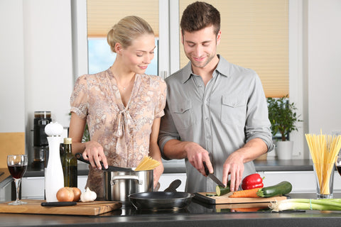 couple cooking in a high traffic area in the kitchen