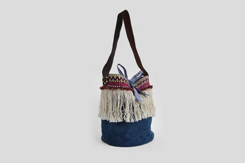 Fringed blue bohemian basket bag