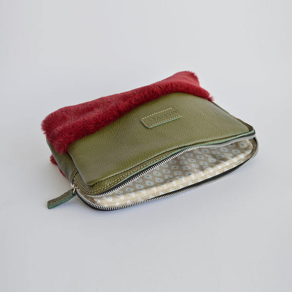 "The ""Half-truth"" pouch in olive green and red"