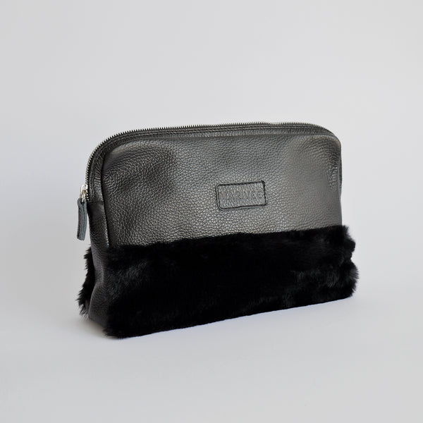 "The ""Half-truth"" pouch in black"