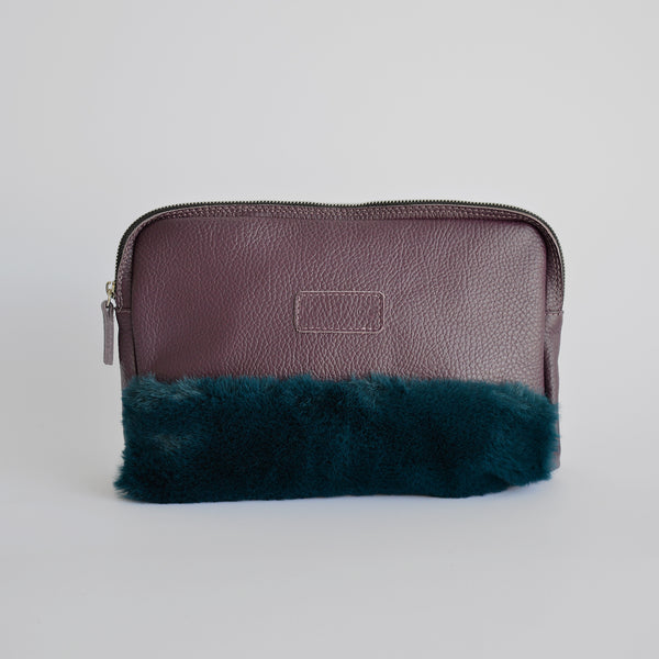 "The ""Half-truth"" pouch in purple and green"